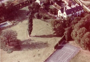 Tennis court and outdoor swimming pool in old rectory